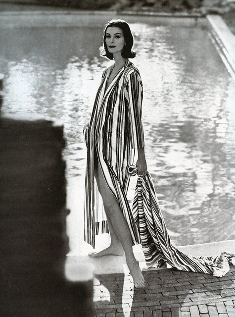 Carmen Dell Orefice in long robe of red, blue and gold stripes on white by Toni Owen, photo by Gleb Derujinski in East Hampton, Harper's Bazaar, 1957