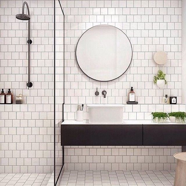Main inspiration for bathroom. Lighter colours open spaces up and make them feel larger, with the same colour tiles used on flooring and walls the space is completely opened up as there isn't a huge contrast to distract the eye. Traditional fittings with dark tones match the existing Art Deco timber features of the apartments and a sleek thinly framed single pane of glass adds a classic contemporary touch, again not being to distracting or chunky to take up too much space.