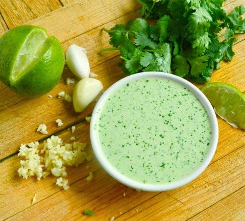 Peruvian Green Sauce Recipe Condiments and Sauces with jalapeno chilies, cilantro leaves, garlic, mayonaise, sour cream, lime, juice, white vinegar, ground black pepper, kosher salt, extra-virgin olive oil