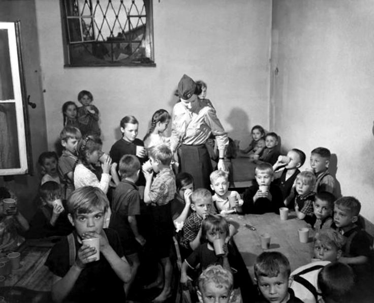 A U.S. Army Public Health nurse attends to a group of Polish war orphans at a displaced persons camp in Bensheim, Germany. Following the end of hostilities, hundreds of thousands of people across Europe were living in displaced persons camps. Combat...