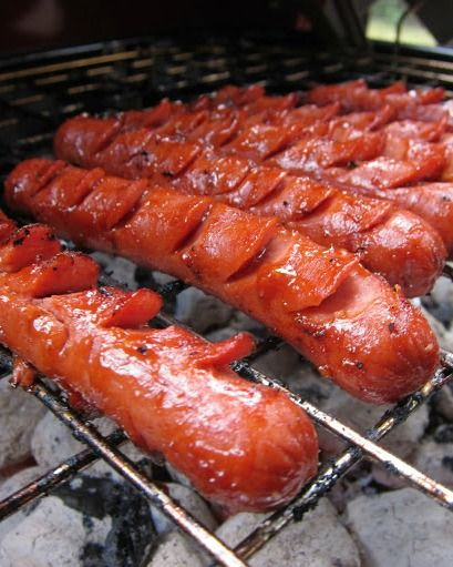 The BEST Marinated Grilled Hot Dogs - 8 hot dogs 1/4 cup ketchup 2 Tbsp Worcestershire Sauce 1 garlic clove, minced 1 tsp vegetable oil With a small, sharp knife, make cuts at an angle in 2 rows down each hot dog, about 1/2 inch apart, cutting partway into the hot dog. The cuts should look like rounded half circles. Mix the ketchup with the Worcestershire sauce, oil and garlic. Pour into a large ziplock bag, add hot dogs and let marinate for 15-20 minutes.