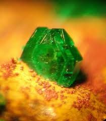 Antlerite. Cu3(SO4)(OH)4. It is chemically and optically similar in many respects to other copper minerals such as malachite and brochantite, though it can be distinguished from the former by a lack of effervescence in hydrochloric acid.Effervescence is the escape of gas from an aqueous solution and the foaming or fizzing that results from a release of the gas.The word effervescence is derived from the Latin verb fervere (to boil), preceded by the adverb ex.