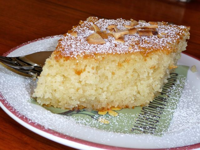 A moist and flavorful semolina cake with a sweet syrup flavored with orange zest.