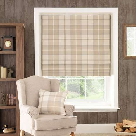 Patterned with a tartan-style check design in natural hues, this Roman blind features a blackout lining to reduce unwanted external light and noise and is avail...