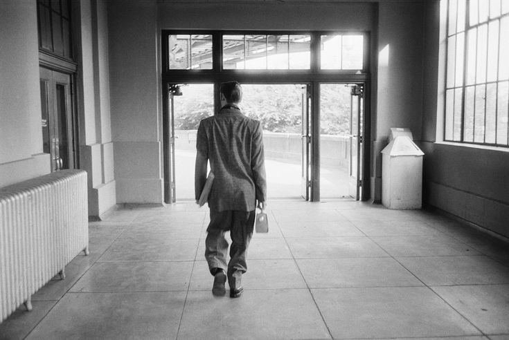 Elvis walking out of the Richmond Train Station, June 30, 1956. In his right hand, he carries a little radio. It was playing music, a precursor to a boom box. Elvis was, as always, ahead of his time. Photographer: Alfred Wertheimer