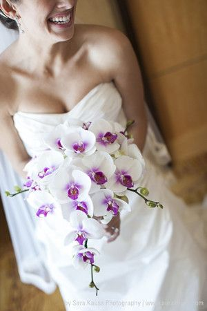 Beautiful bridal bouquet incorporating Phalaenopsis orchids for purple wedding ideas 2014