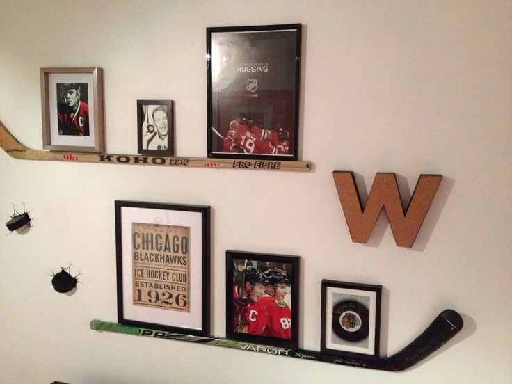 Photo collection with hockey stick shelf. Chicago Blackhawks boy's bedroom.