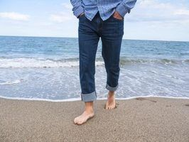 A pin roll can give your jeans a leaner, more tapered look.