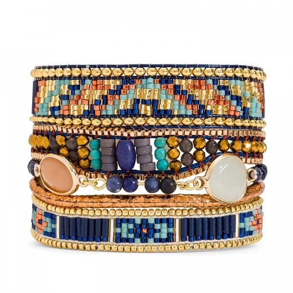 The Hipanema Lazuli Women's Bracelet features a cuffmade of beaded links in rich blue hues, adorned with a khaki colored stone inspired byancient Egypt. Lengt