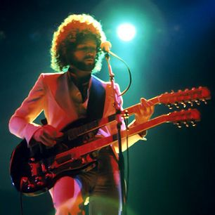 """Lindsey Buckingham - During Fleetwood Mac's hitmaking era, Lindsey Buckingham transmuted the folk music of his banjo-playing youth into stadium rock: glistening harmonized leads, crisply snapping chords and frenetic arpeggiated breakdowns. """"It's not acceptable classical technique,"""" he has said. """"You do what you can to get the sound you want."""""""