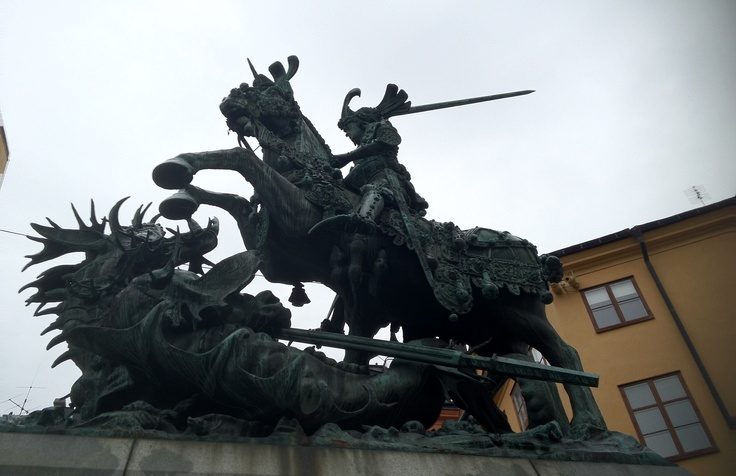St. George and the dragon. They had a major role in Sweden and the symbolism surrounding the country's liberation from the Nordic union, supported by the Pope. This bronze copy of Bernt Notke wooden statue that still stands in Storkyrkan (big church). This copy was erected in 1912-1913 and was a gift of Hjalmar Wicander.