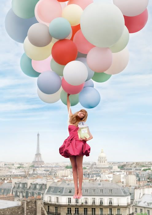 We love this picture! Who wouldn't want to do their shopping and then fly off with lots of balloons?