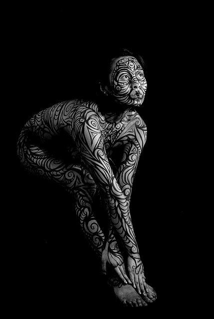 Dark and swirling body paint