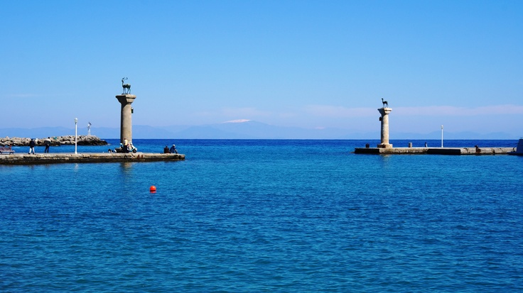 Rhodes Island Greece -  The entrance to the Mandrake harbor - The two bronze deer - characteristic landmarks of the island