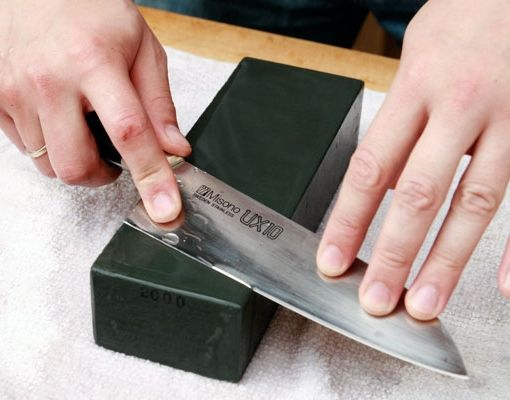 The best method by far for sharpening knives is to use a sharpening stone. Not only will it give you the best edge, it also removes the least amount of material. Here's how VIA Serious Eats.