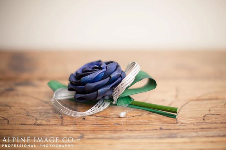 Stunning buttohole with a blue flax rose, silver hapene ribbon and green flax foliage.  By Artiflax <3