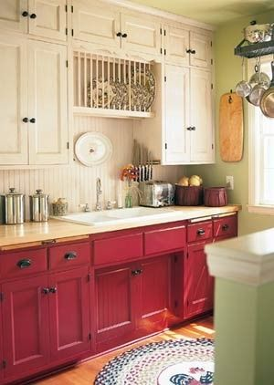 luurve this kitchen!  red cabinets, butcher's block counters, pan/plate rack over the sink...