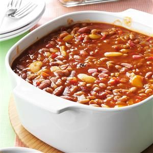 Slow Cooker Calico Beans Recipe -With so many folks moving to meatless or healthier food choices, I decided to remove the meat from the original recipe but turn up the flavor. The savory veggie blend balances the sweetness of the baked beans. —David Dixon, Shaker Heights, OH