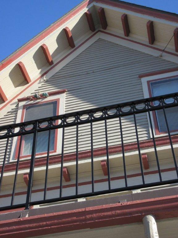 Custom iron deck railing with cast circle designs ...