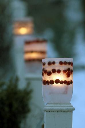 Make a glowing parfait by alternating layers of cranberries and ice. Use a 2-liter bottle for the outside of the mold, and create a hollow place for the candle with a 1-liter bottle.