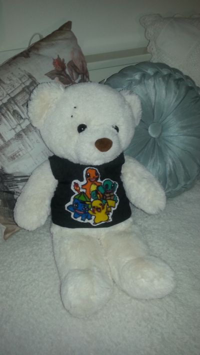 Michael Clifford teddy. T-shirt and piercings. DIY