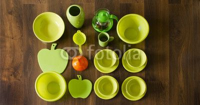 green dishes top view with an orange funnel