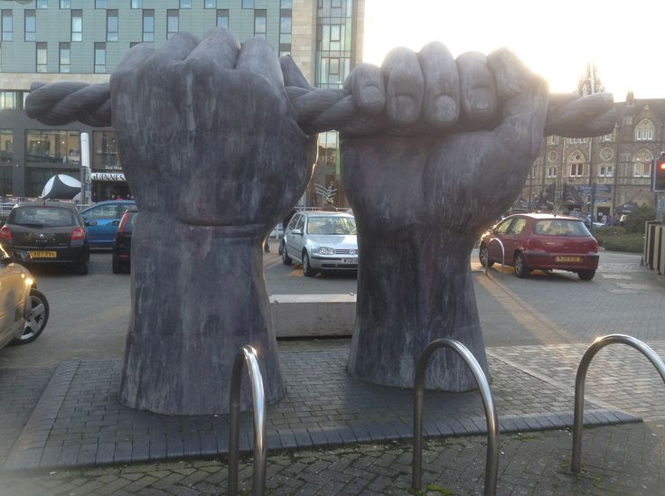 All Hands (2001) Custom House St. Cardiff, UK. 3m high sculpture in galvanised steel of two fists clutching a rope is a tribute to the toils of the canal boatmen by Brian Fell.