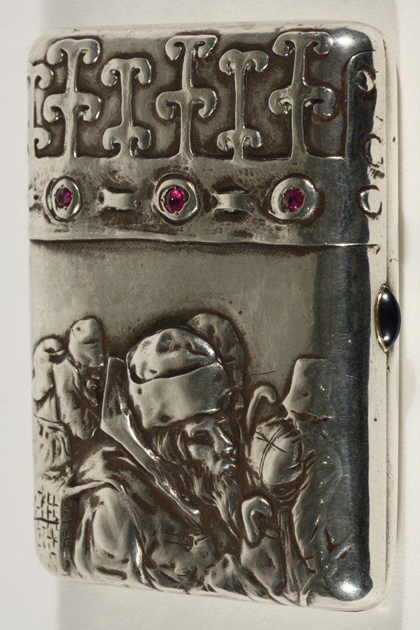 Faberge sterling cigarrette case with inset rubies, c1899-1908 - the front panel has images of men walking in repousse, a band set with three rubies runs along the top third of the case,with a blue cabochon thumb piece, Faberge hallmark, assayer's mark of Ilya Lebedkin, Moscow, 84 standard