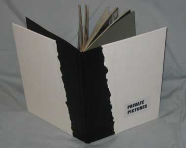 Private Pictures by Nicholas Heath. 30 x 21 x 1.5 cm White kangaroo leather, black kangaroo tail insert. This is a completely revised paperback book. After stripping the sections free of the old covers, the sections were resewn onto tapes and bound in black and white kangaroo in a simplified binding. Not being myself an artist my thought went to reworking a book as black and white photographs 'Private Pictures' being found in a local second hand book shop. The pictures themselves are…