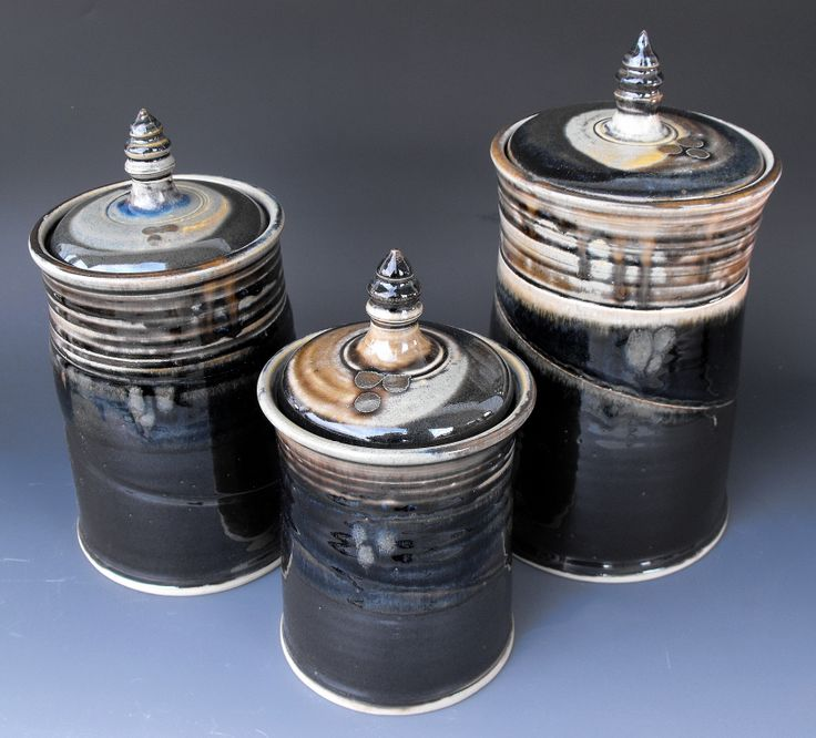 Set of 3 canisters. Thrown porcelain. Fired to 1300 degrees centigrade. Dishwasher, oven and microwave safe.
