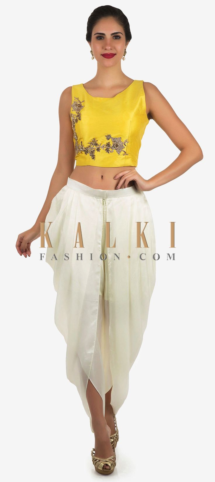 Buy Online from the link below. We ship worldwide Click Anywhere to Tag White and yellow dhoti suit enhanced in zardosi embroidered work only on Kalki  Dance away the night at your besties sangeet ceremony in this dhoti suit. The crop top in raw silk is featured in yellow. It is intricately constructed using the zardosi floral motif embroidery work. Matched with a white dhoti in satin with a front zip opening. Slight variation in color is possible.