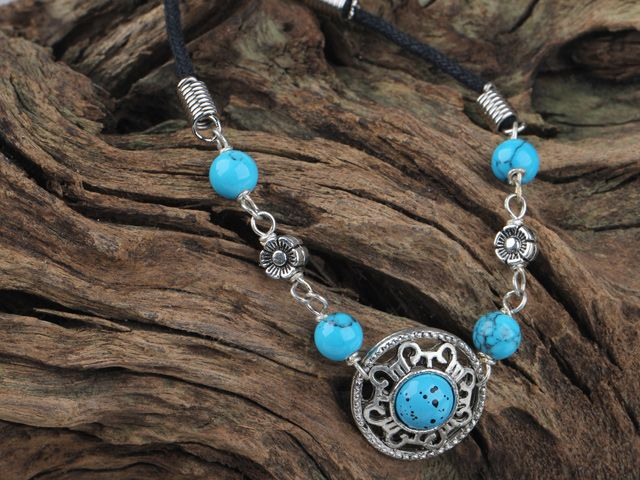 Cute Turquoise, Silver on a Black Cord Bracelet. I love it!