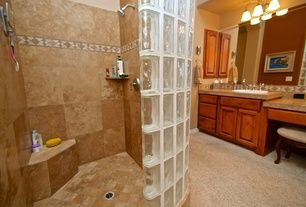 """Craftsman Master Bathroom with High ceiling, Built-in bookshelf, Carpet, Glass Block 8"""" x 8"""" Icescapes Block by Daltile.  Like shower, cabinets, counters.  Don't like wall color or accessories.  Yank out carpet"""