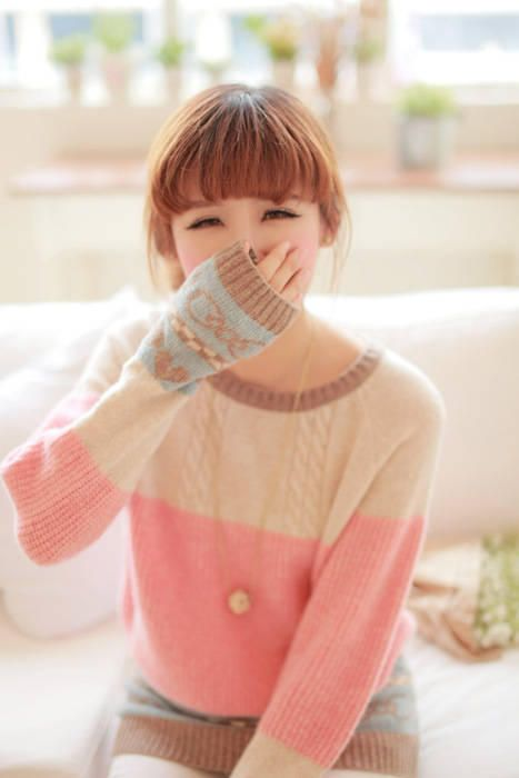 Cream and light blue and light pink and brown sweater
