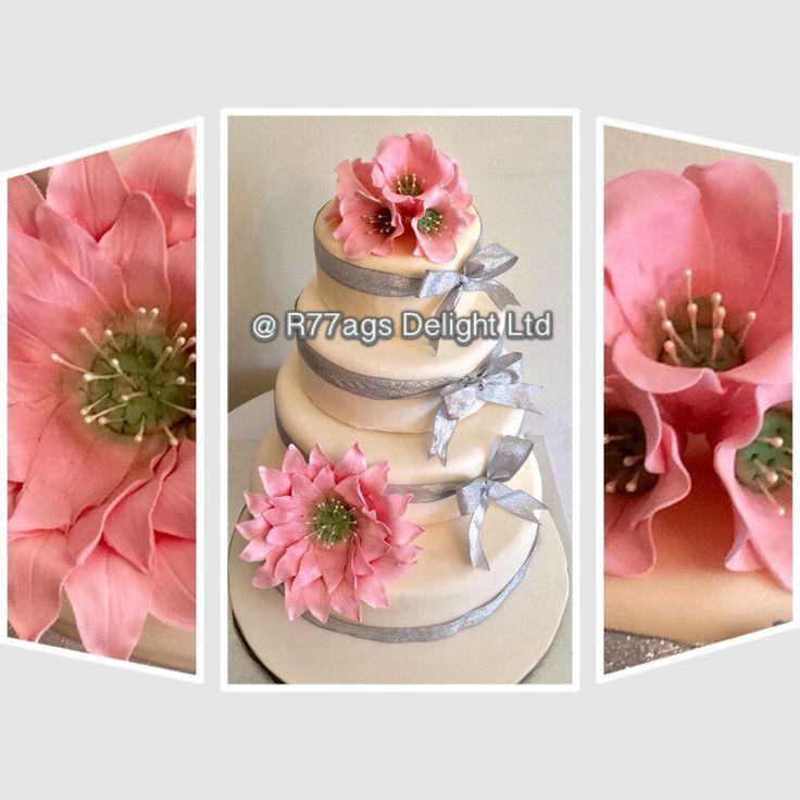 Pink Sunflower!! Four tier wedding cake of vanilla sponge filled with pineapple/rum buttercream http://www.facebook.com/R77aga https://plus.google.com/109392342848883386604/posts/BYrzYicV25J