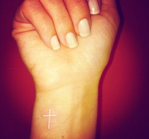 See more White ink cross tattoos on wrist