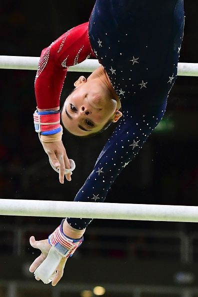 US gymnast Alexandra Raisman competes in the qualifying for the women's Uneven Bars event of the Artistic Gymnastics at the…