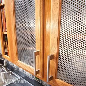 Remodel your kitchen quickly and easily by cutting out old wooden door panels and installing new, striking materials, like metal, glass or fabric. Do it yourself to keep the cost low.