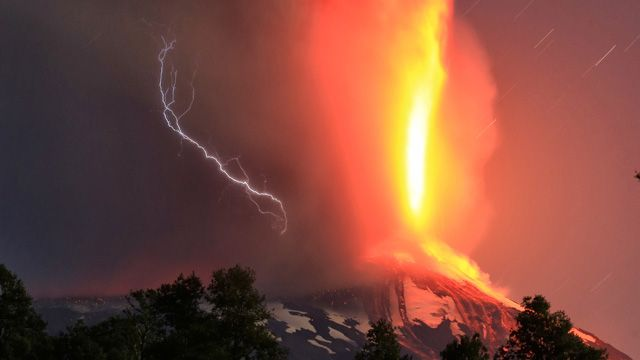 The 2800m Villarrica volcano, one of Chile's most active, has begun erupting.<br><br> In this image a lightning strike can be seen striking the mountain at the same time as the lava spews into the sky.<br><br>(AAP)