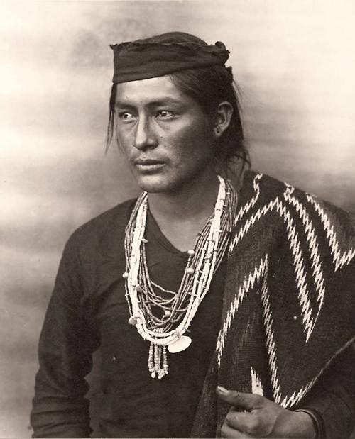 "Leradr:  ""Poo-wish-ke-ja-le-kiss,"" a Navajo young man, Painted Desert, Arizona. ca 1900. Photo by Frederick Monsen."