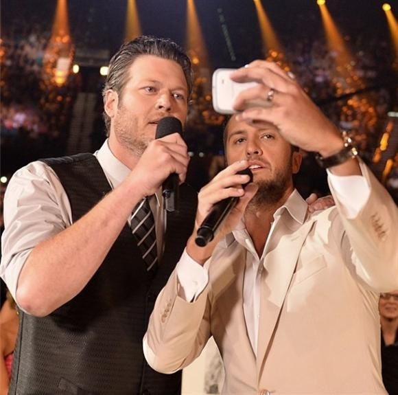 """Loving Thy SelfiePoking fun at Oscar host Ellen DeGeneres' epic A-list selfie, AMC Awards co-hosts Blake Shelton and Luke Bryan debated taking one with country music's elite. But they then found funny reasons to pass over some of the biggest stars in the front row including George Strait (""""I can't talk to him,"""" said Luke in awe), Jason Aldean (""""He's not big enough,"""" Luke reasoned) and Tim McGraw (in unison the co-hosts shouted, """"Bor-ing!""""). They finally decided to keep it simple. """"I think…"""