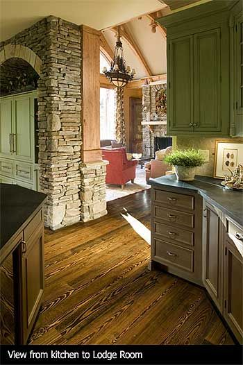 Rustic Craftsman Kitchen- would want herringbone wood tile floors and different colors for cabinets- like the style of cabinet and stone around the refrigerator that looks like an armoire.