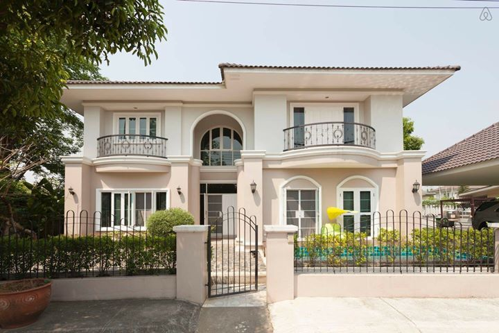 Two-story house with round balconies | House styles