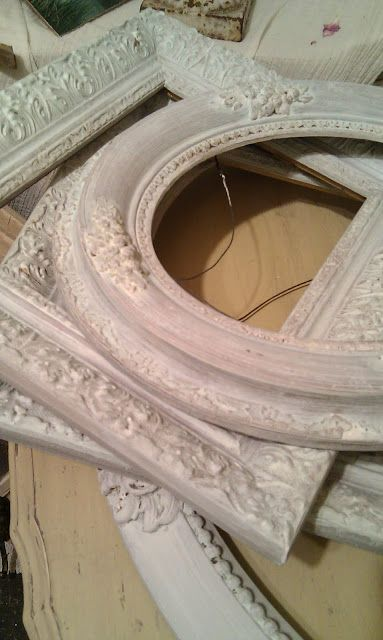 Apply Gesso to frames to give them a vintage look and give them depth.
