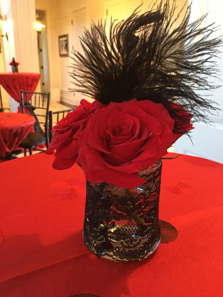 Even our tiny vases featured black lace and feathers! Moulin Rouge inspired party