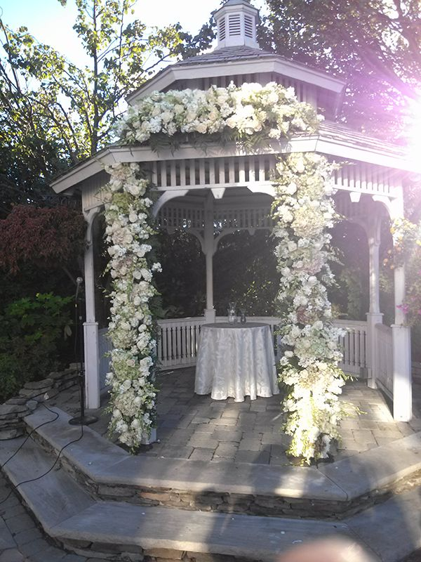 Wedding arbor decoration ideas custom florals chuppahs for Outdoor wedding gazebo decorating ideas