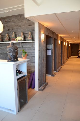 Love this hallway with the wood and the lights. ....Yoga Classes Photo Gallery | Breathe Yoga Studio