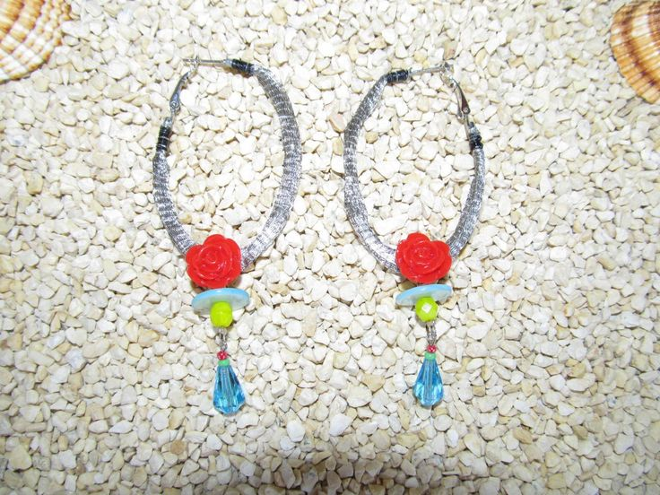 Handmade earrings (1 pair)  Made with antiallergic oval hoops, metal basket cord, red plastic flowers, mother of pearl and glass beads.