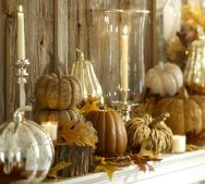 Beautiful display for the mantle.  J.Lee Home Decor has mercury glass gourds and a glass vase grounded with a silver base to help add a bit of shine to the warmth of the autumn colors.
