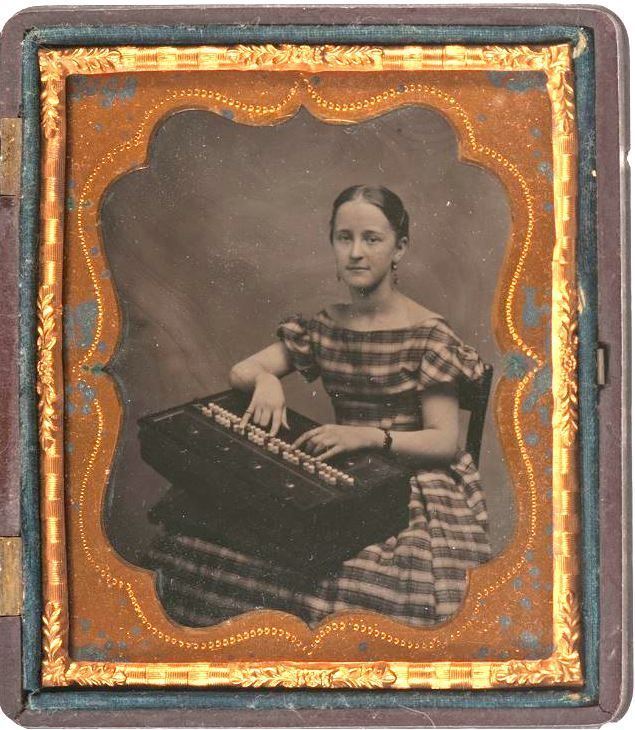 ca. 1850-60s, [tintype portrait  tintype of a young woman posed with a her rocking melodeon] via Cowan's Auctions